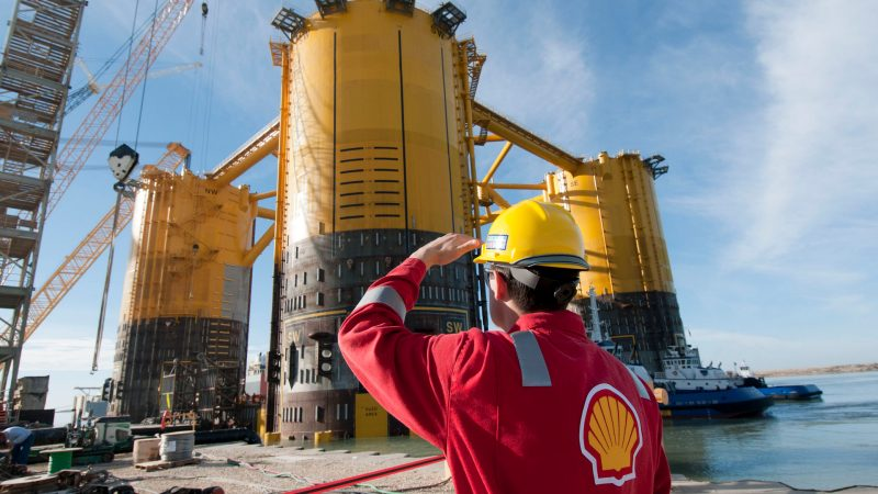 engineer-in-red-uniform-with-yellow-hard-hat-by-marsb-platform-construction.jpg